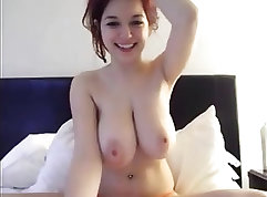 Babe with large natural tits masturbates on cam