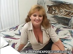 Busty Mom stroking young cock