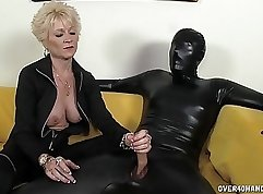 Bosomy granny and her slave are playing football