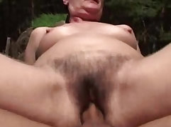 Blonde chick with hairy pussy is having passionate sex outdoors