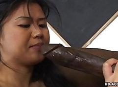 Asian Betty Mori suck a thick ebony cock