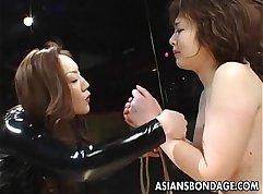 Asian MILF with sexy hair bondage