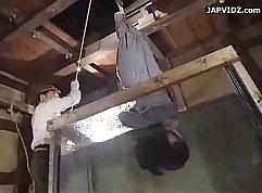 Teen Asian takes bondage position