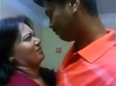 an indian kissing in her mall store