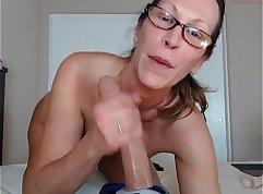 Watch MILF twerks huge dick while licking tits